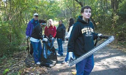 Volunteers organized by PA CleanWays bag trash.