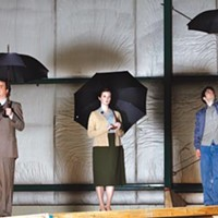 Weather advisory: (from left) Daniel Krell, Daina Michelle Griffith and Nick Lehane in Quantum Theatre's When the Rain Stops Falling