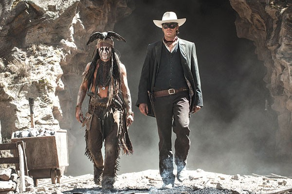 Who are these masked men? Tonto (Johnny Depp) and the Lone Ranger (Armie Hammer)
