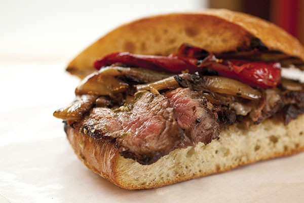 Wood-grilled beef sandwich with peppers, onions and chimichurri sauce