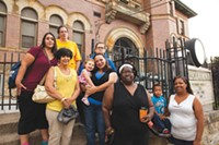 Woolslair parents believe a STEAM magnet program could save their school. Pictured from left: (front) Barb Squires, Valerie Allman and daughter Lily, Tommy Jeter, Jaline Cunningham and son Jaivin, (back) Donna Harper, Bertha Weimer, Christine