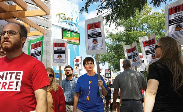 Workers and supporters picket at the Rivers Casino in August