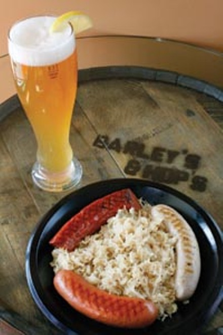 Wurst plate, with sausages and Bavarian-style sauerkraut, and wheat beer - HEATHER MULL