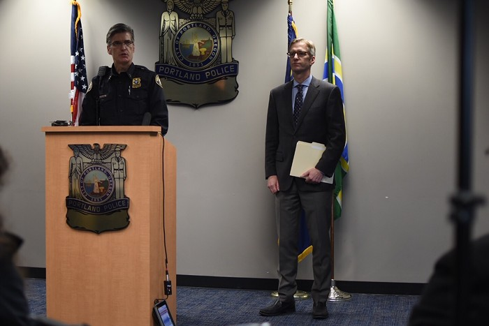 Portland Police Chief Mike Marshman, left, and Mayor Ted Wheeler, right, at a press conference Friday afternoon