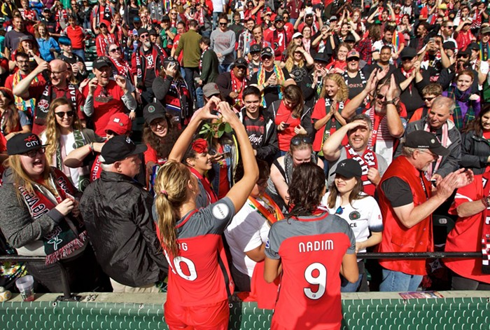 The feeling is mutual! Allie Long and Nadia Nadim show their love for the Riveters.