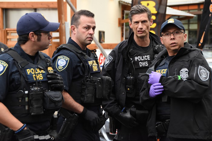 Federal cops planning the arrests of the linked-up protesters