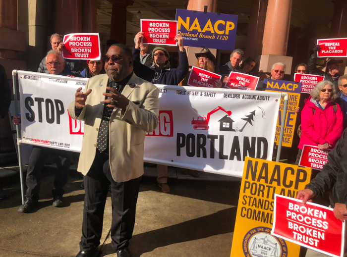 E.D. Mondaine, president of Portland's NAACP chapter, speaks at a rally outside Portland City Hall Wednesday morning.