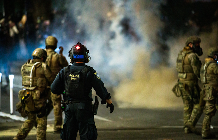 Portland Police work in concert with federal officers to tear gas and disperse protesters, Friday July 17.