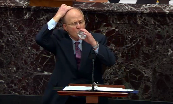 Trumps idiot impeachment lawyer unsuccessfully tries to drink water and rub his head at the same time.