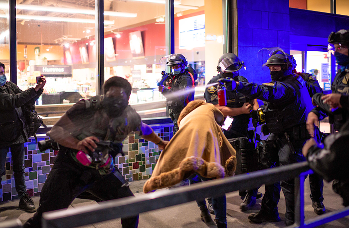 Portland officers pepper-spray protesters Friday night.