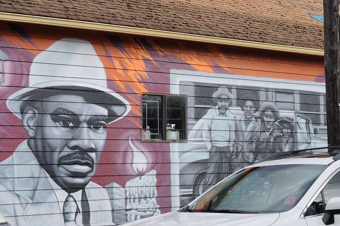 A mural by the artist Campo Graphic on the side of Courtesy Janitorial Services on NE Alberta and 17th depicts the businesses founder, Floyd Booker Sr.