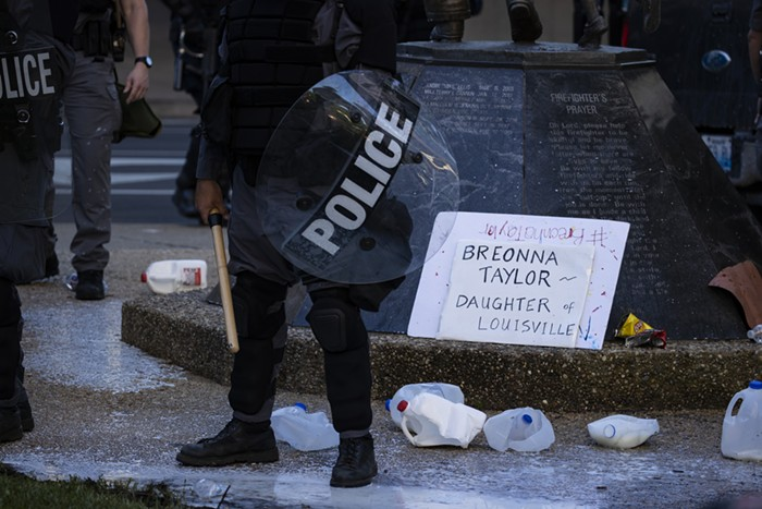 Louisville police officers in riot gear during a May 2020 protest in honor of Beronna Taylor, a woman slain by Louisville cops.