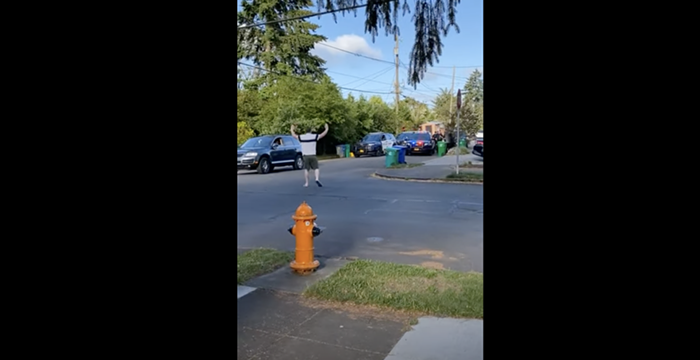 A screenshot of a video, taken by Swales, showing Cox approaching a vehicle containing two unresponsive men Tuesday.