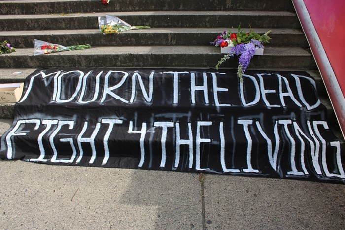 A large black sig with white letters reading Mourn the dead, fight 4 the living