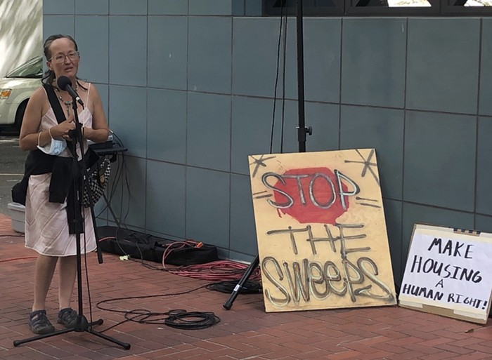 Barbara Weber speaking at a rally prior to Tuesdays public hearing.