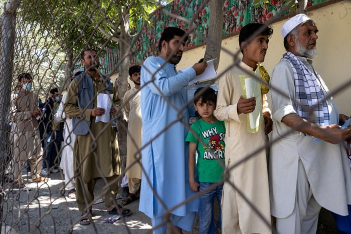 Afghans wait in line at the passport office in Kabul, Afghanistan on August 14, 2021.