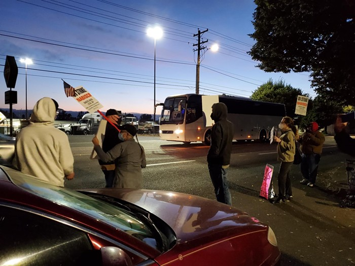 A strike supporters car blocks a company bus from entering the Nabisco factory.
