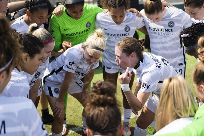Thorns players huddle together for a pep talk