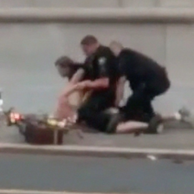 click the picture to see a video of an officer using a Taser on Klug (NSFW language)