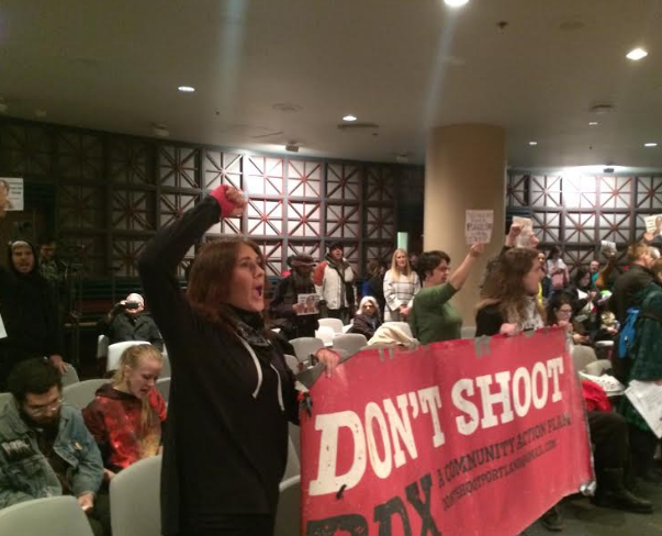 Demonstrators disrupt a Portland City Council meeting on Wednesday morning