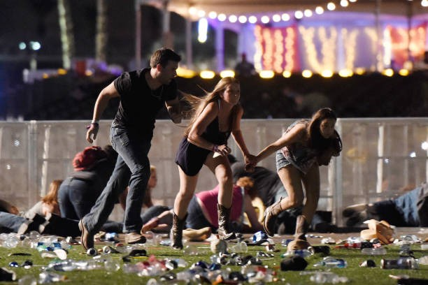 Concert-goers flee from a mass shooting in Las Vegas.
