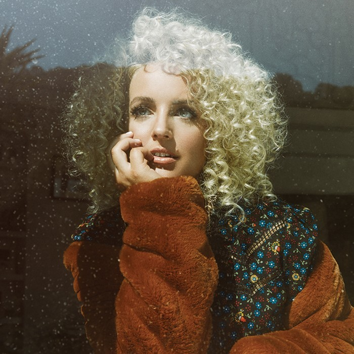 CAM Combining Queen, Dolly Parton, and super soft fuzzy outerwear.
