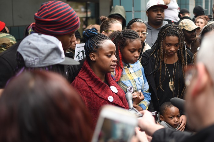 Venus Hayes talks to reporters outside of the Multnomah County Justice Center.