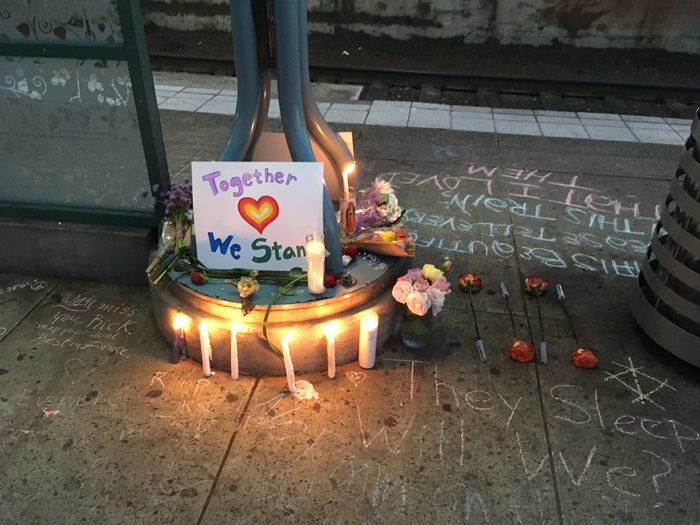 A memorial at the Hollywood Transit Center in 2017, after two people were stabbed to death on a MAX train during a hate-fueled encounter.