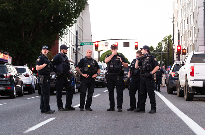 A gaggle of Portland police responding to the scene of a fatal officer shooting in June.