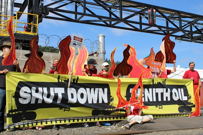 Demonstrators from Extinction Rebellion protesting in front of the Zenith Energy terminal in Northwest Portland.