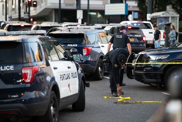 Portland police officers in Northeast Portland on June 24, 2021, shortly after a police officer fatally shot a member of the public.