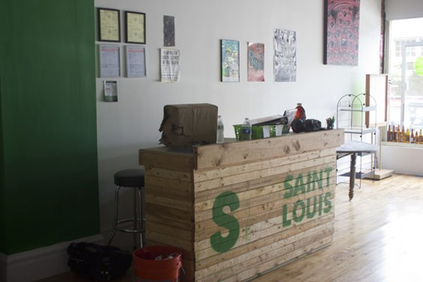 "The front counter at Saint House Hop Shop, with its yet-to-be-completed ""So St. Louis"" sign. - PHOTO BY SARAH FENSKE"