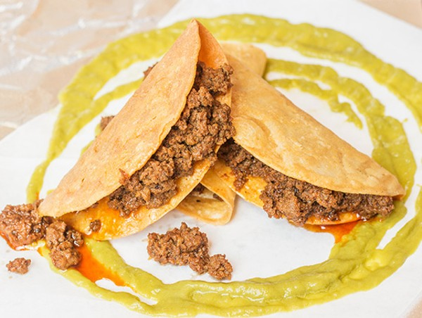 Three ground-beef tacos in crispy tortilla shells. - MABEL SUEN