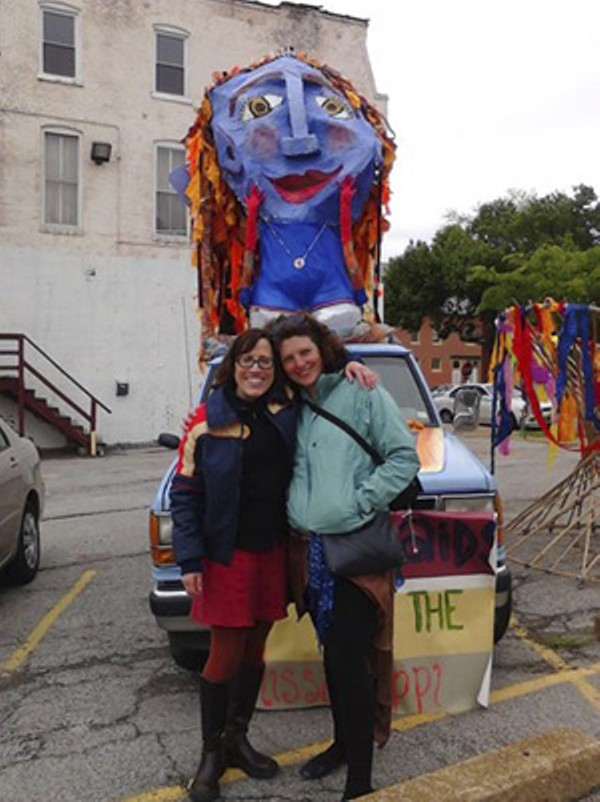 Sallie Durbin and co-founder Sarah Paulsen in front of the Mermaids by the Mississippi. - ELISA FORGELMAN