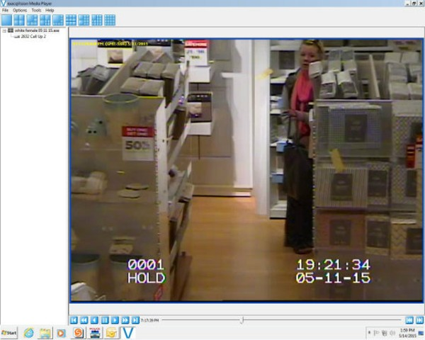 Police say this surveillance photo shows a woman accused of tasing a loss prevention officer at the Mid-Rivers Mall. - COURTESY OF THE ST. PETERS POLICE DEPARTMENT
