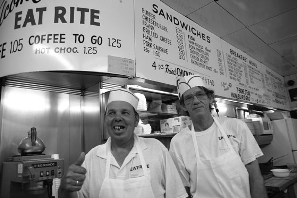 Kevin Hadley (left) and Pat Fell. When the two co-workers have opposite shifts, they call each other to compare sales - PHOTO BY NICHOLAS PHILLIPS