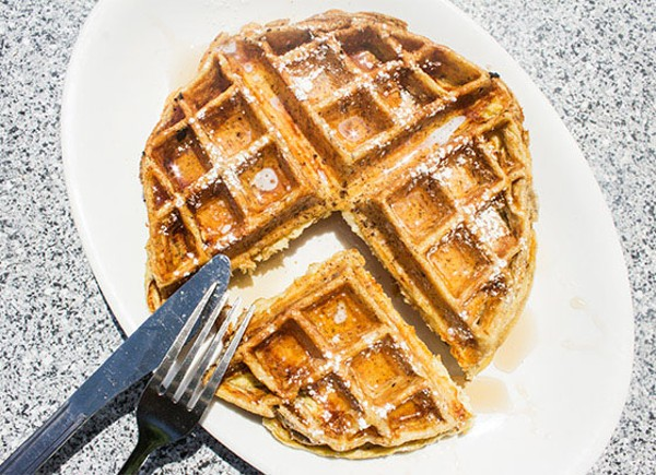 Waffled French toast with maple syrup and butter. - MABEL SUEN