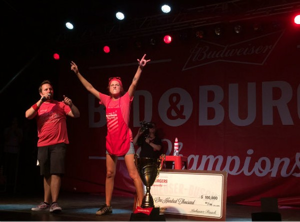 Angie celebrates her victory on stage. She received $100,000 that will go towards opening her own burger establishment. - EMILY MCCARTER