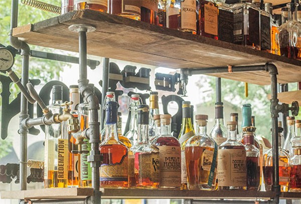 The BBQ Saloon boasts some 520 bottles of whiskey and plenty of other booze, too. - MABEL SUEN