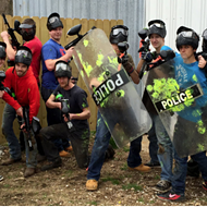 Expedia Touts the Real St. Louis Experience with Police Shields, Riot Gear