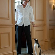 Jim Carrey and his tuxedoed friends on a grim march to nowhere in <i>Mr. Popper's Penguins</i>