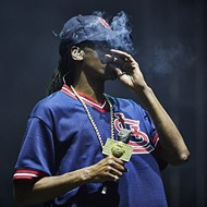 Here's Snoop Dogg Smoking a Blunt in an Ozzie Smith Jersey at LouFest