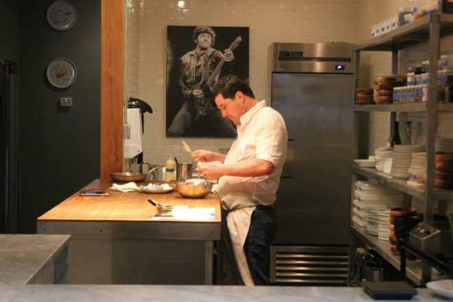 Mike Randolph and his sous chef, the Boss. - CHERYL BAEHR
