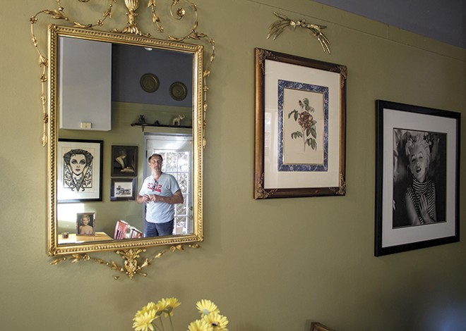 The decor in Kevin's Place includes Antique Row merch and portraits of Marilyn Monroe (who reminds him of an ex-girlfriend). - PHOTO BY SARA BANNOURA