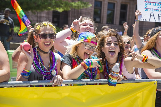 Pridefest attendees celebrate the LGBTQ community in downtown St. Louis. - PHOTO BY SARA BANNOURA