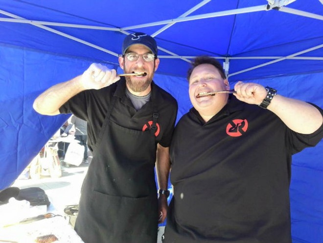 Vernon's owner Matt Stiffelman and his teammate, Hunter Rose, celebrate at the Dallas Kosher BBQ Championships. - COMPLIMENTS OF MATT STIFFELMAN