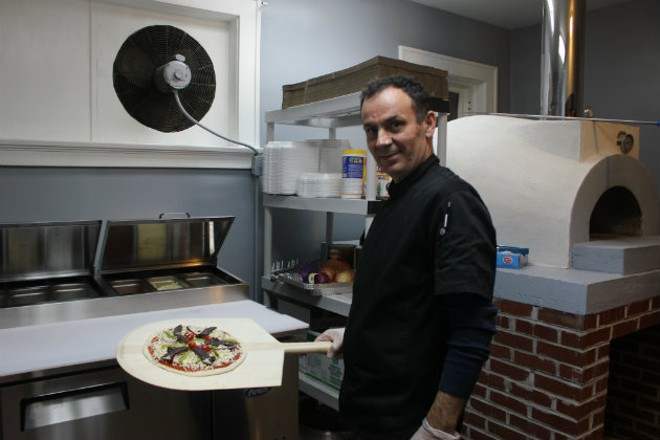 Brahim Mehmetaj honors his family's roots at Eni's Pizzeria. - CHERYL BAEHR