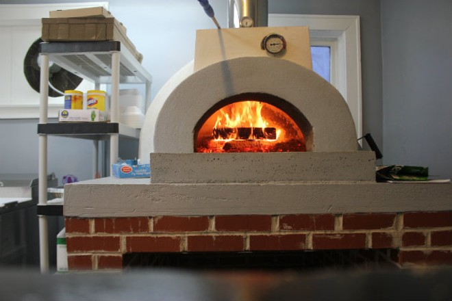 Eni's pizzas are cooked in a wood oven. - CHERYL BAEHR