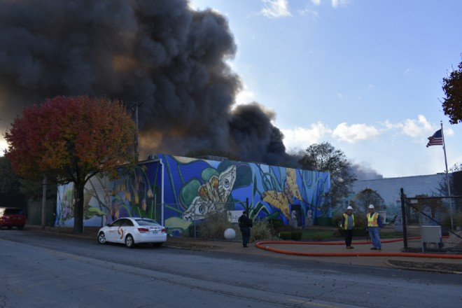 Smoke pours over the neighborhood from a warehouse fire in Botanical Heights. - PHOTO BY DOYLE MURPHY