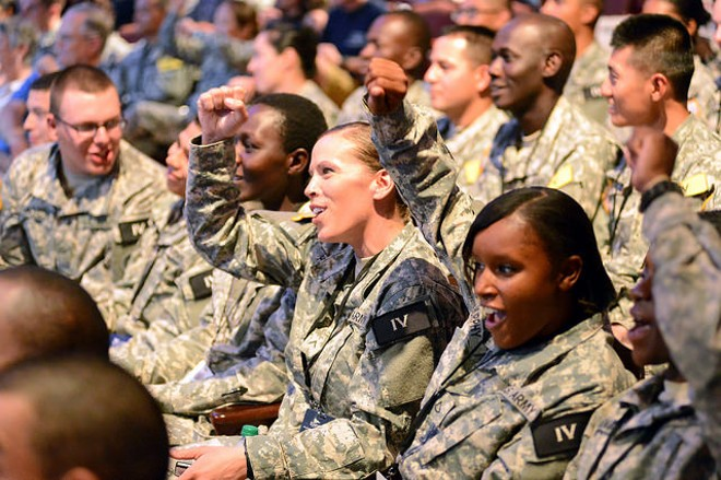 Soldiers cheer entertainment at a base in Texas. The U.S. Army has recently released a database cataloguing reports of assault. - COURTESY OF FLICKR/U.S. ARMY